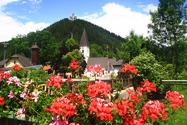 Veitsch village view with flowers in the foreground.