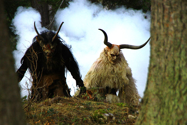 Two Krampuses in the woods.